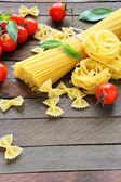 Uncooked pasta and ingredients — ストック写真