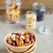Nuts in a bowl and jars — Stock Photo