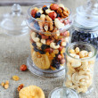 Nut mix in glass jars — Stock Photo