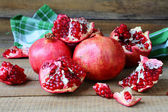 Fresh juicy pomegranates on the heap — Stock Photo