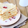 Fragrant breakfast crepes with cream — Stock Photo #38829363