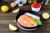 Fresh salmon fish in pan — Stock Photo