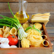 Pasta and ingredients on wooden background — ストック写真