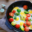 Healthy and nutritious breakfast - fried eggs with vegetables — Stock Photo