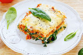 Lasagna with meat and spinach — Stock Photo