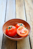 Fresh ripe tomatoes in a bowl — Stok fotoğraf