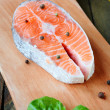 Stock Photo: Salmon steak and seasoning