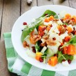 Salad with slices of baked pumpkin — Stock Photo #39493395