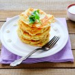 Potato pancakes with sour cream — Stock Photo