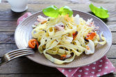 Tasty pasta with assorted seafood — Stock Photo