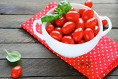 Fresh cherry tomatoes in a large bowl — Stock Photo