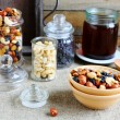 Nuts and honey in jars — Stock Photo