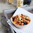 Assorted nuts in ceramic bowl on a tray — Stock Photo