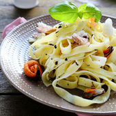 Nutritious pasta with seafood — Stock Photo