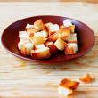 Stock Photo: Bread croutons on plate