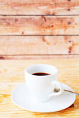 Black coffee in a white cup — Stock Photo