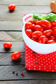 Fresh cherry tomatoes in a white bowl — Stock Photo
