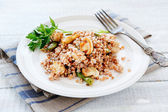 Buckwheat porridge with mushrooms fried — Stock Photo