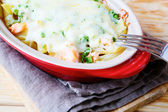 Baked pasta and cheese with smoked salmon — Stock Photo