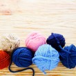 Balls of colored yarn on the boards — Stock Photo #41538283