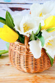 Spring flowers in basket, tulips — Stock Photo