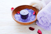 Sea salt in bowl and candle — Stock Photo