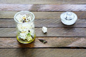 Marinated feta in a jar — Stock Photo