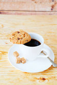 Cup of black coffee and cookies — Stock Photo