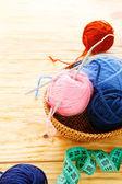 Balls of yarn and knitting needles — Stock Photo