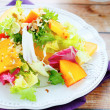 Diet salad with persimmons — Stock Photo