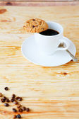 Invigorating cup of coffee and cookies — Stock Photo
