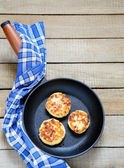 Fritters in a frying pan — Stock Photo