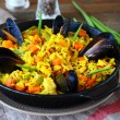 Hot paella with vegetables and mussels — Stock Photo