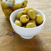 Olives in a white bowl — Stock Photo