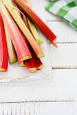 Pink rhubarb stalks on the boards — Stock Photo