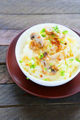 Flavored potatoes with fried mushrooms — Stock Photo