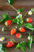 Strawberries on a wooden table, top view — Stockfoto