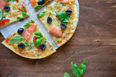Thin crispy pizza with fish — Stock Photo