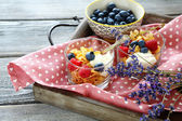 Healthy Breakfast for two.Oat flake, berries and flowers — Stock Photo