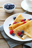 Light crepes with fresh berries — Stock Photo