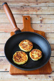 Three pancakes in a frying pan — Stock Photo