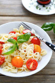 Appetizing pasta farfalle with tomatoes — Stock Photo