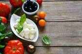 Mozzarella balls and other foods — Stock Photo