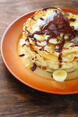 Rustic with banana pancakes — Stock Photo