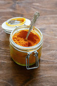 Eastern spice turmeric in a jar — Stock Photo