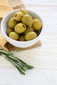 Pickled green olives in ceramic bowl — Stock Photo