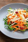 Carrots, celery, cabbage salad with arugula — Stock Photo
