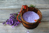 Aromatic bath salt and bunch of lavender — Stock Photo