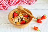 Granola with strawberries and chocolate chips — Stock Photo