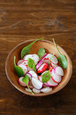 Crispy radish salad with spinach — Stock Photo